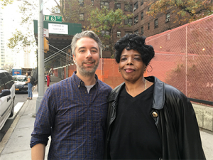 John Skies, Video Director with Gilda Menendez, PAN Grant Recipient smiling outside on sidewalk